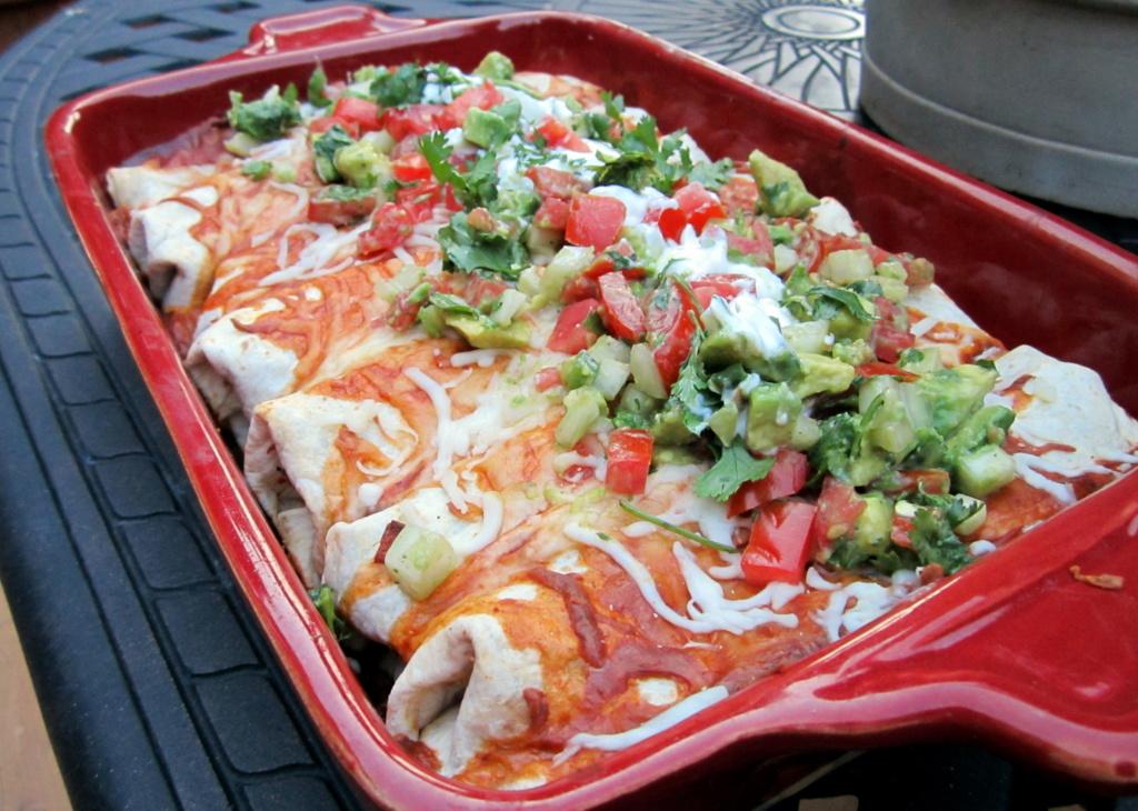 black bean chicken enchiladas in a pan
