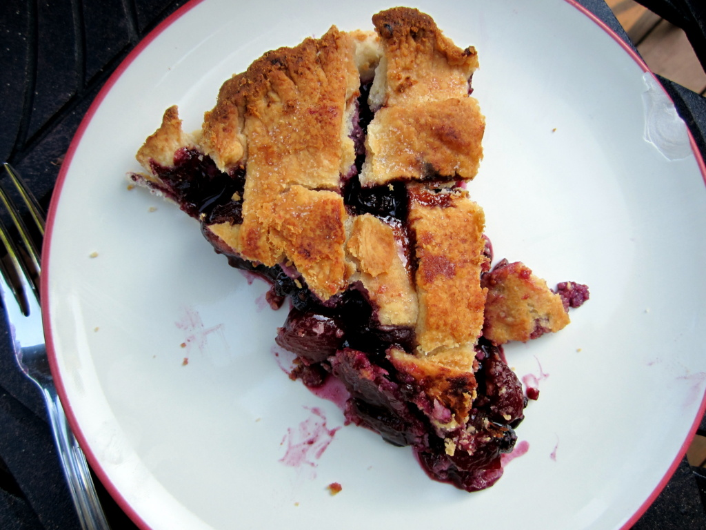 slice of summer berry peach pie