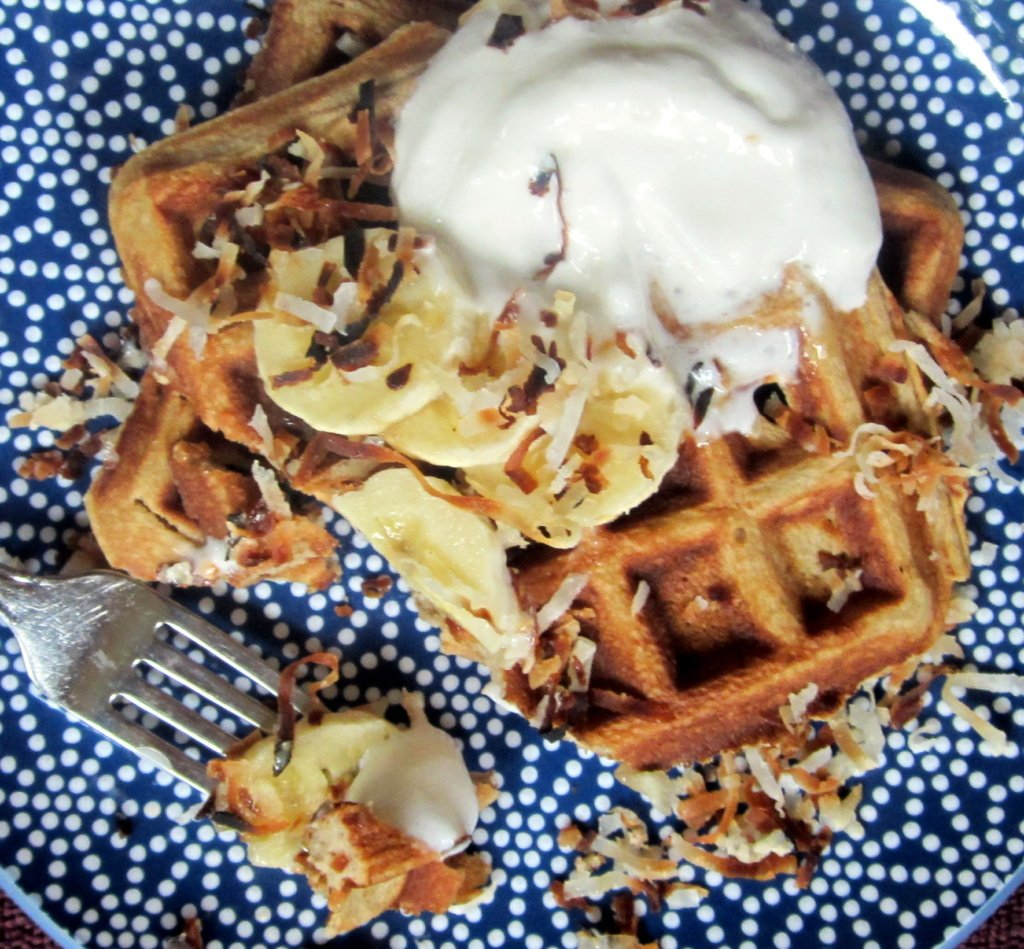 coconut flour waffles on a plate with bananas on top