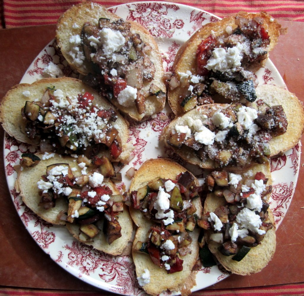 roasted eggplant and zucchini bruschetta on a plate