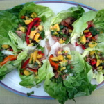 thai lettuce wraps side by side on a plate