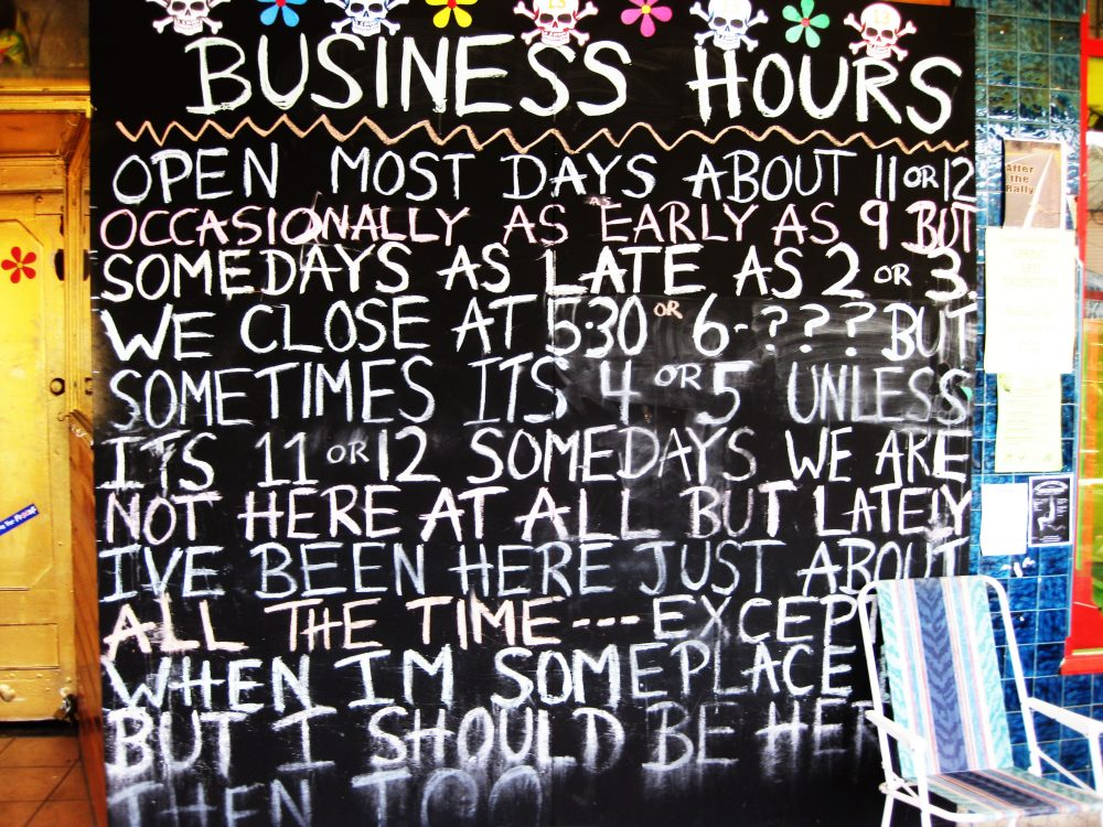 Business hours sign outside of a restaurant