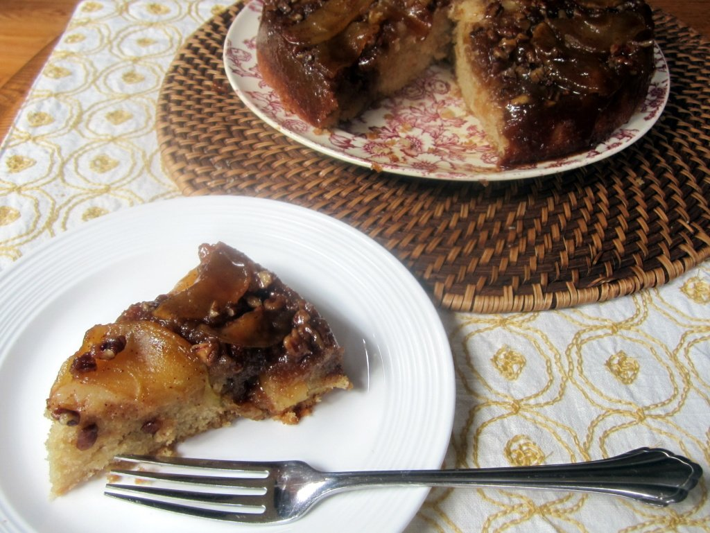 slice of upside-down caramel apple pecan cake on a plate