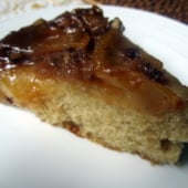 slice of upside-down caramel apple cake on a plate