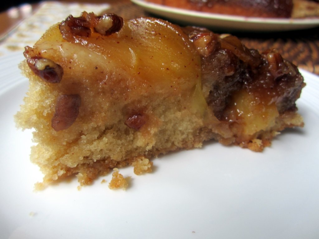 slice of caramel apple upside-down cake on a plate