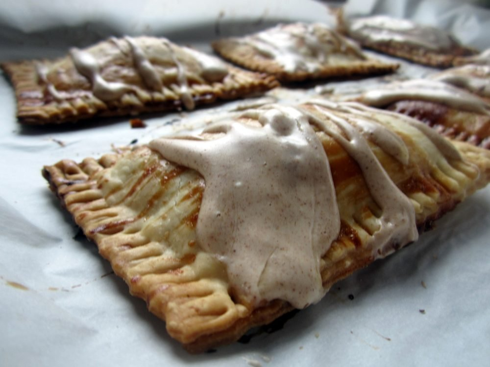 homemade pumpkin cream cheese pop tart with frosting on top