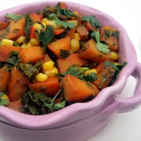 roasted spanish potatoes in a bowl with corn and kale