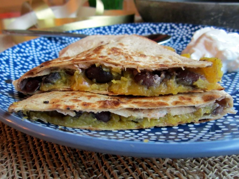 Easy, delicious acorn squash and black bean quesadillas loaded with sweet, creamy squash, savory black beans, and your favorite melty cheese. Perfect for a quick lunch or weeknight dinner.