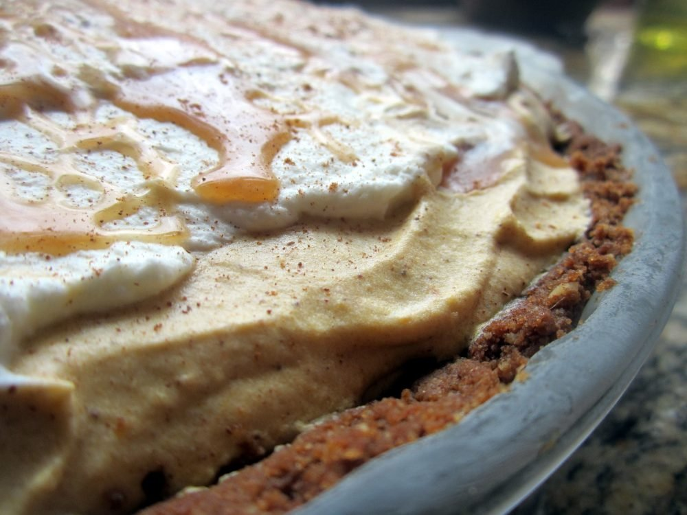 Incredible dulce de leche pumpkin mousse pie with a perfectly spiced pecan gingersnap crust. Everyone will love the delicious pairing of pumpkin and caramel in this amazing pie!