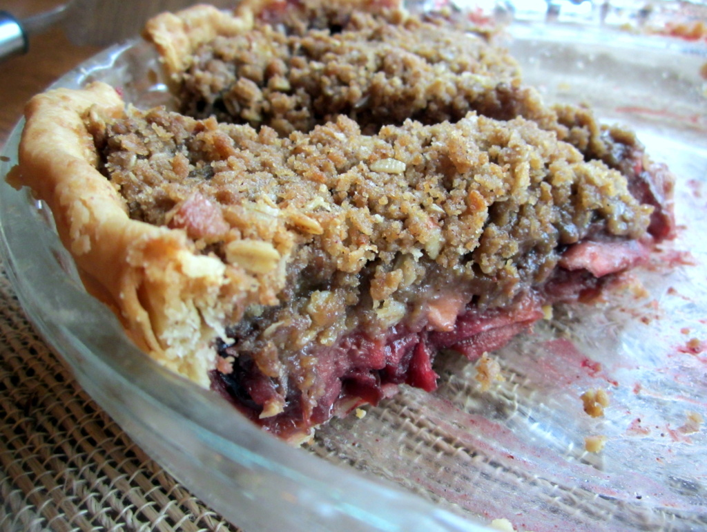 deep dish bourbon apple cherry pie in a pie dish