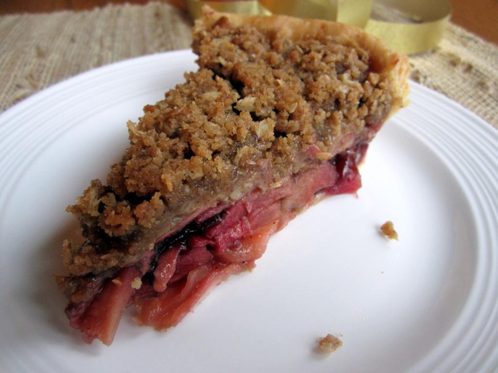 slice of deep dish bourbon apple cherry pie on a plate