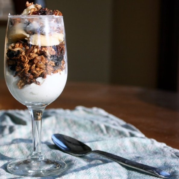 yogurt and naturally sweetened maple granola in a glass