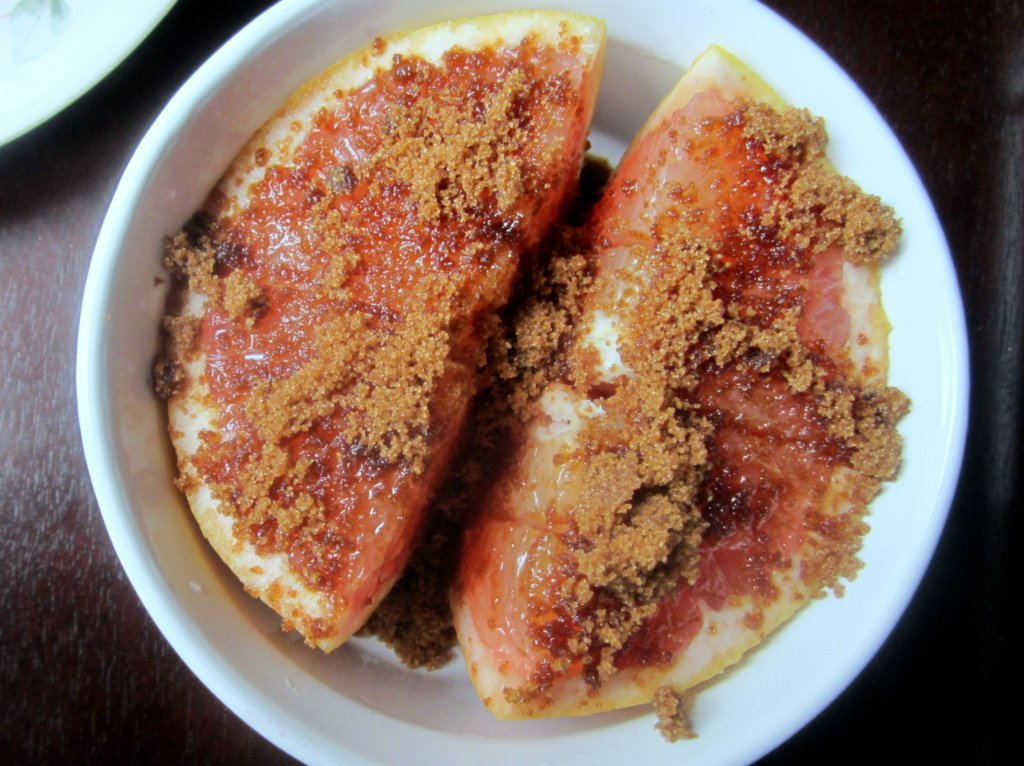 grapefruit in a bowl with brown sugar