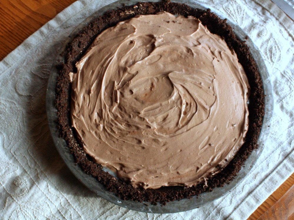 Creamy chocolate mousse & teddy graham birthday pie made with an easy, chocolate teddy graham crust and a perfectly whipped chocolate topping. This pie is perfect for celebrations an delicious frozen!