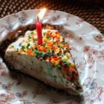 teddy graham birthday pie with a candle on a plate