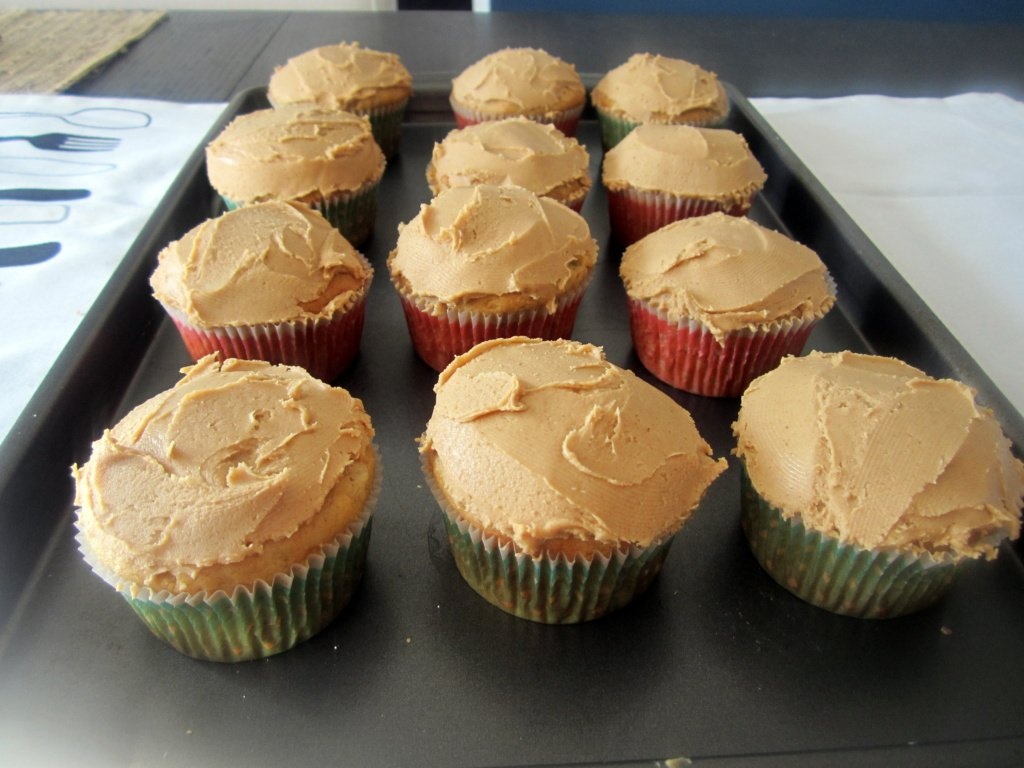 chocolate peanut butter banana cupcakes on a tray