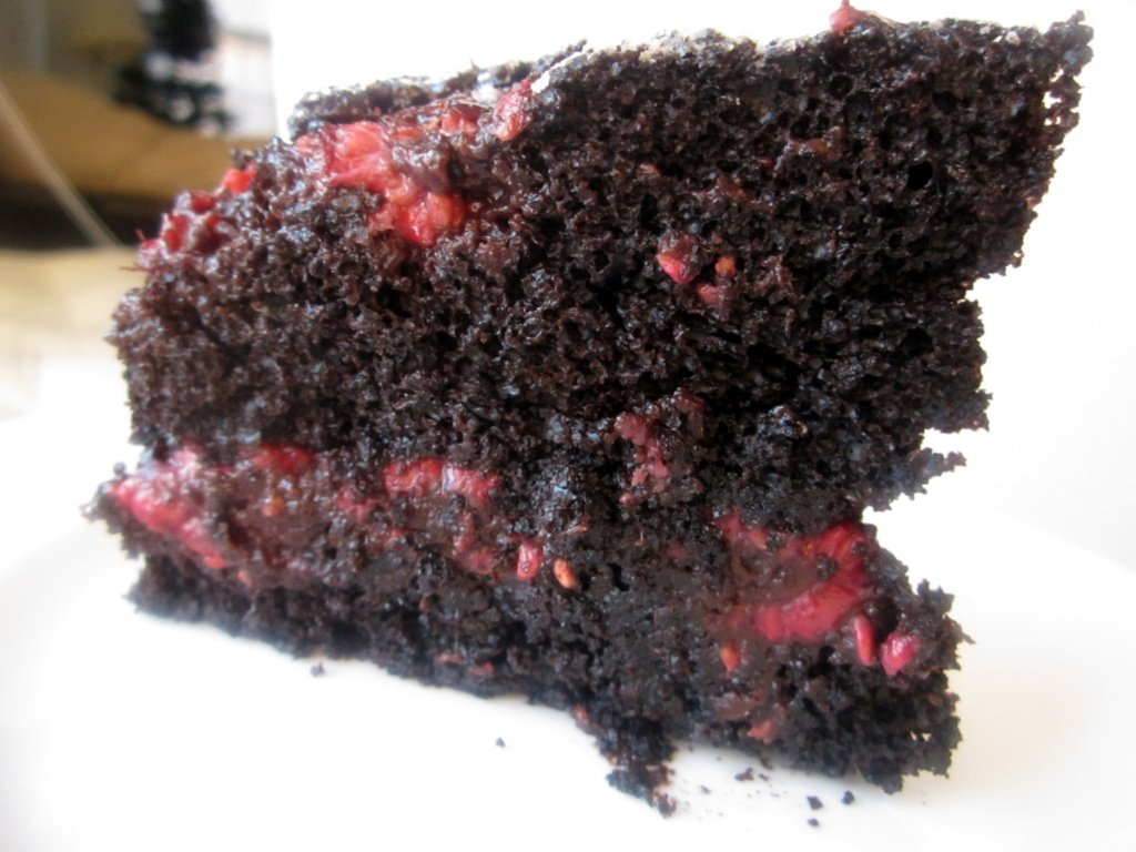 slice of dark chocolate raspberry upside-down cake