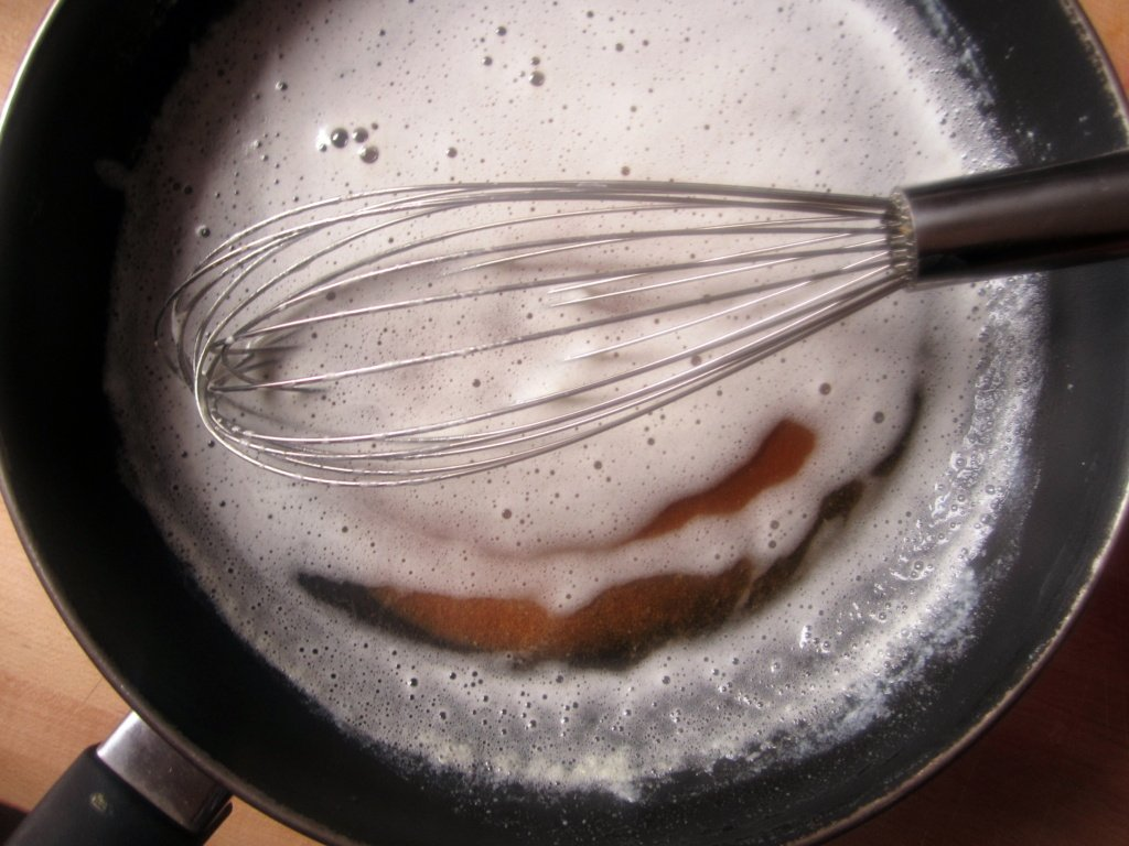 brown butter in a pan with a whisk