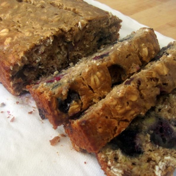 Fluffy, delicious low fat oatmeal blueberry banana bread made with simple ingredients and a boost of protein from greek yogurt. You're going to love this blueberry banana bread for a healthy breakfast or snack any day of the week.