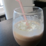 Chocolate-Banana Coconut Milkshakes in a glass with a straw