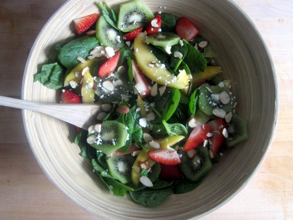 This strawberry, mango & kiwi spinach salad is packed with juicy mangos, gorgeous kiwis, sweet strawberries, toasted almonds and a sprinkle of goat cheese. Perfect for summer lunches, parties, and picnics.