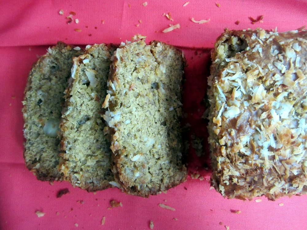 Moist and delicious white chocolate, macadamia nut & coconut banana bread baked with toasted coconut on top. This unique banana bread is perfectly sweet and great for brunch.