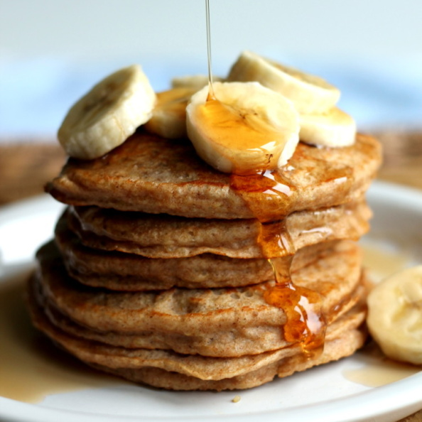 Fluffy whole wheat banana quinoa pancakes packed with protein from quinoa and greek yogurt. The perfect healthy breakfast that's freezer friendly and delicious with your favorite toppings.