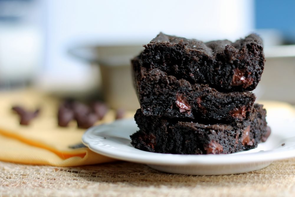 sea salt and double dark chocolate brownie cookie bars in a stack on a plate