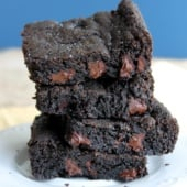 sea salt and double dark chocolate brownie cookie bars stacked on a plate