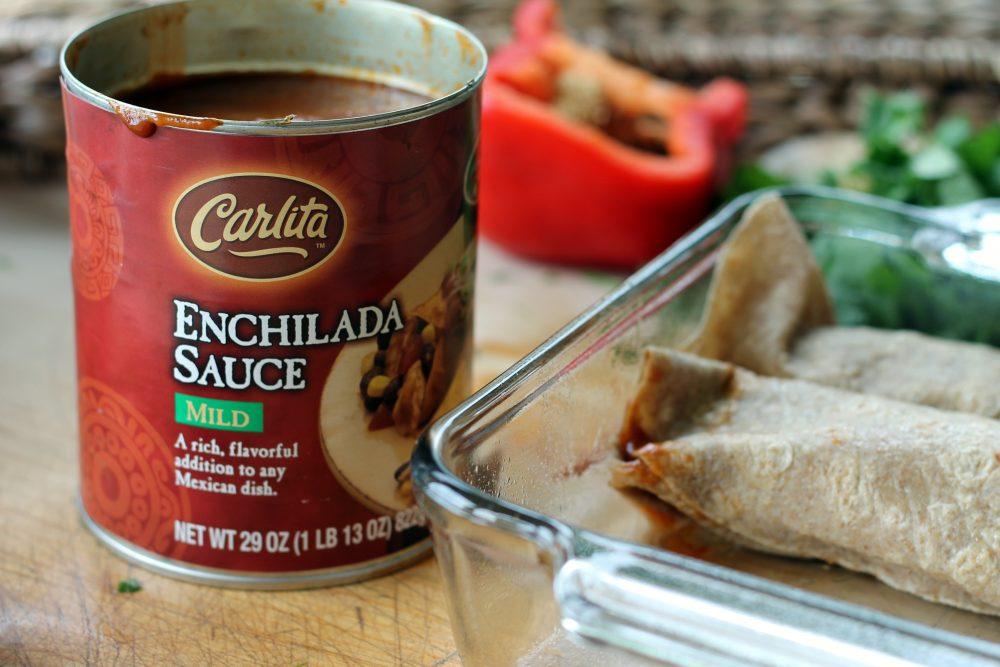 huevos rancheros breakfast enchiladas next to a can of enchilada sauce