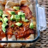 Incredible skinny huevos rancheros breakfast enchiladas rolled up with protein packed scrambled eggs, fresh veggies, and melty cheese, then baked in a delicious enchilada sauce. Perfect for breakfast meal prep or weekend brunch!