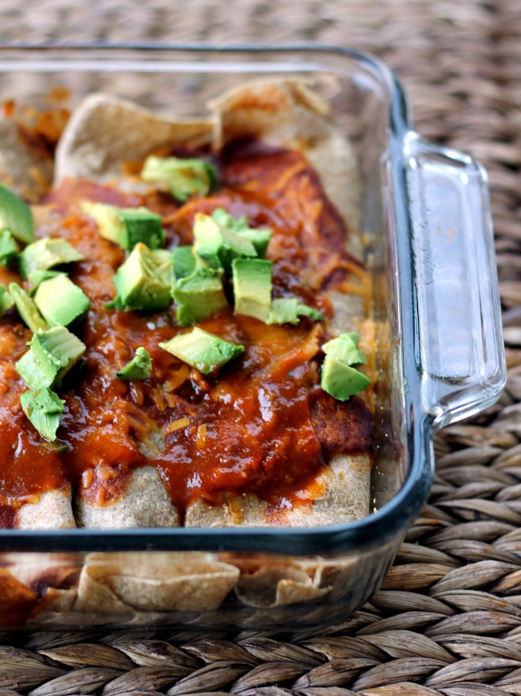 skinny huevos rancheros breakfast enchiladas in a glass pan