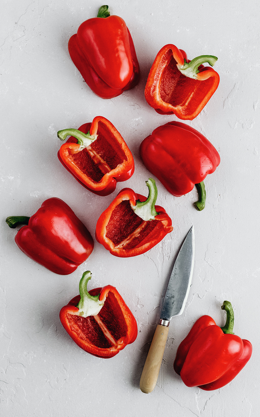 red bell peppers sliced in half to make quinoa stuffed bell peppers