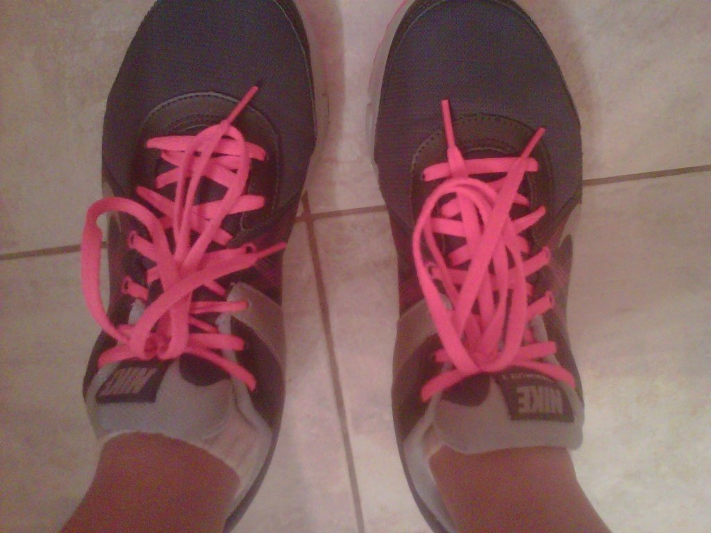 Running shoes with pink laces