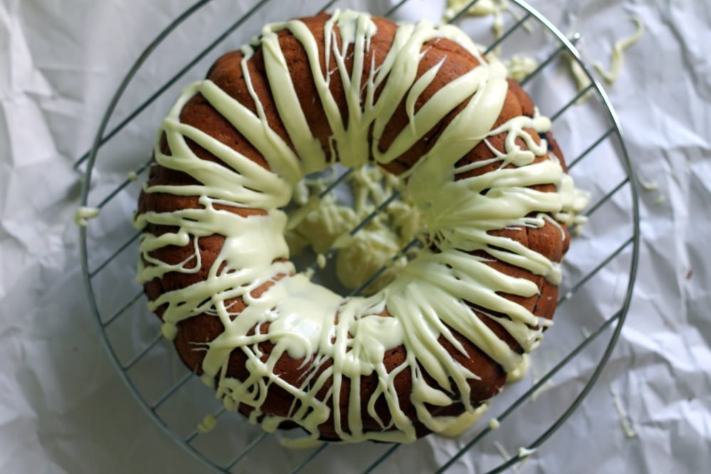 lemon bundt cake on a cooling rack