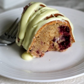Gorgeous lemon bundt cake made with fresh blackberries, greek yogurt, a zesty lemon cream cheese glaze, and lightened up to perfection with less butter.