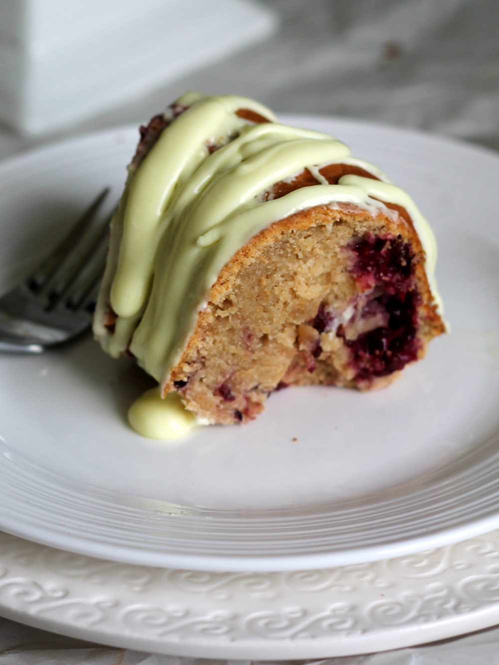 slice of lemon bundt cake made with fresh blackberries