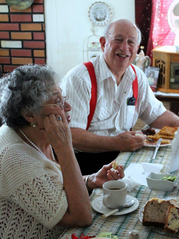 A grandma and grandpa at the breakfast table