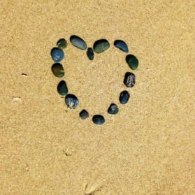 Heart shaped in rocks on the beach