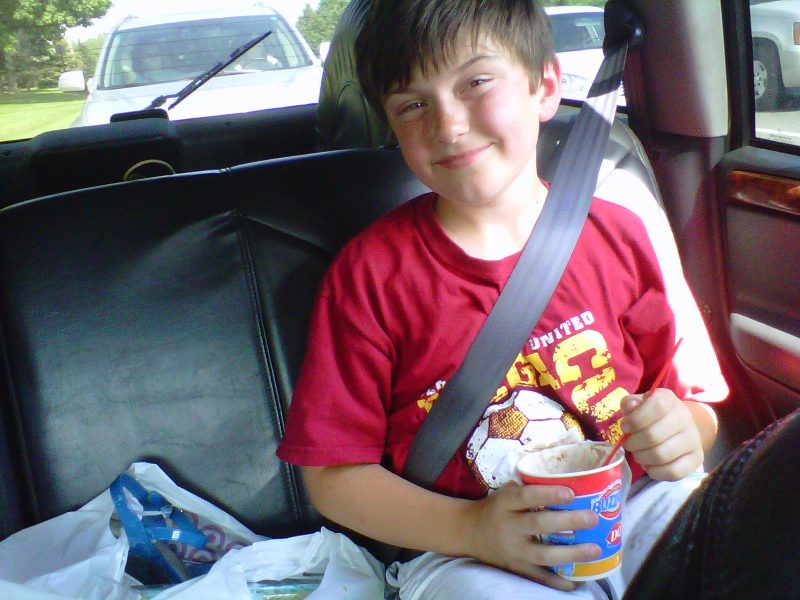 Ben in the backseat of a car