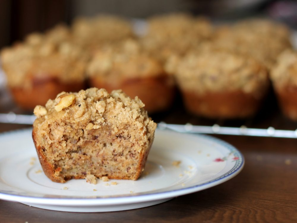 Fluffy, better-for-you healthy banana muffins with a perfectly sweet brown sugar walnut crumble. These healthy banana muffins are lower in fat & sugar for a delicious muffin that's perfect for breakfasts or snacks.