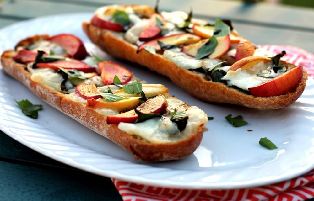 Incredible peach, basil, and brie french bread pizzas made with fresh summer ingredients like juicy peaches and flavorful basil. They're drizzled with a delicious balsamic reduction for the perfect sweet and savory combination.