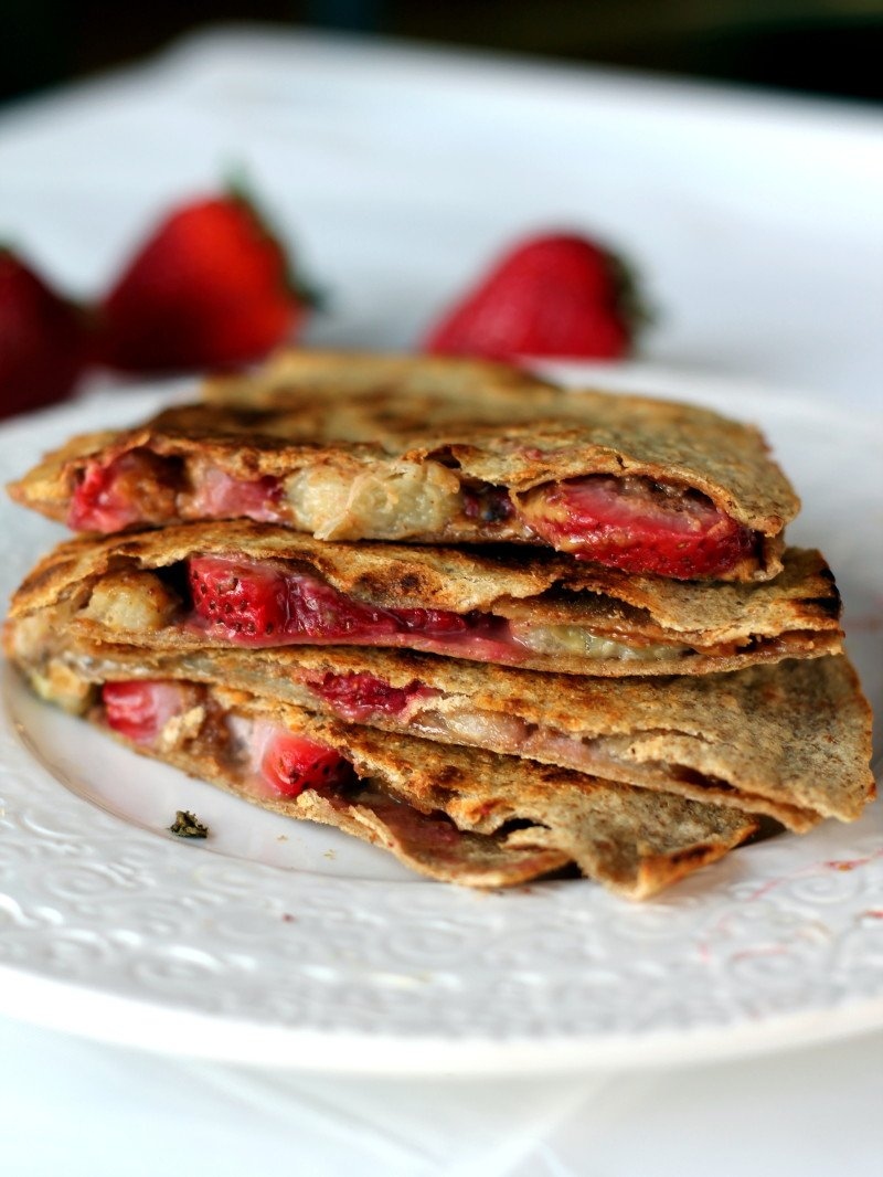 Delicious banana quesadillas with creamy peanut butter and fresh strawberries. An incredible cross between your favorite pb&j and a hearty breakfast quesadilla that's perfect on the go!