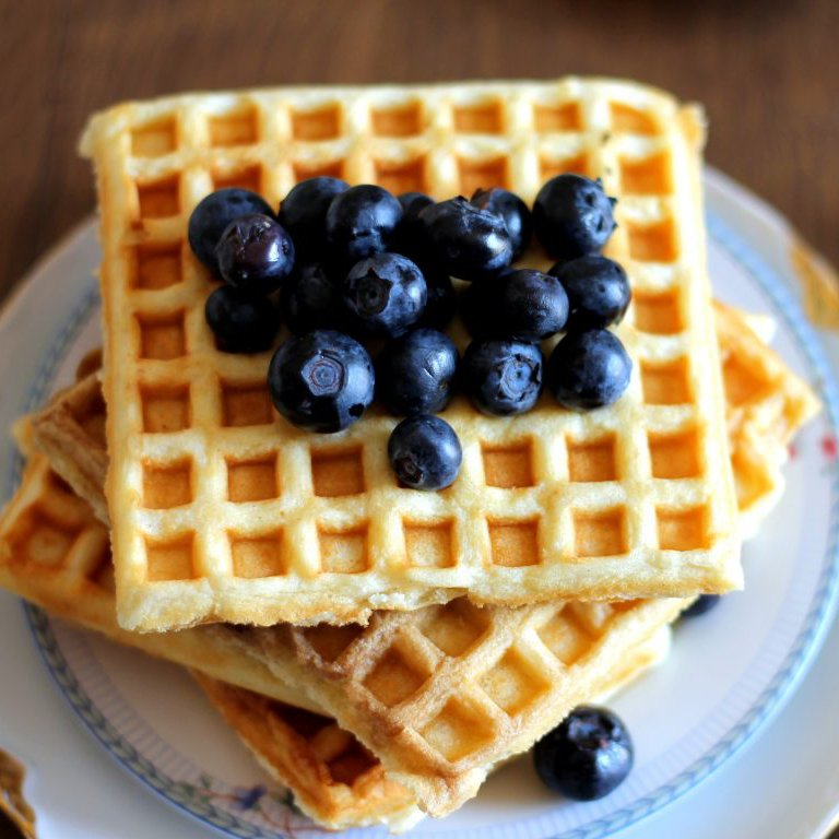 Grandma's incredible, classic buttermilk waffles are made with simple ingredients for the fluffiest homemade waffles that are perfectly crispy on the outside. Top them with fresh berries and a drizzle of pure maple syrup for the best breakfast or brunch!