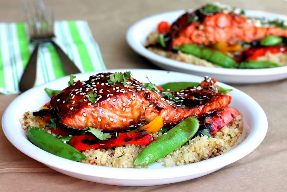 Delicious sesame ginger sweet teriyaki salmon served with a veggie-packed garlic quinoa stir-fry. This bright, flavorful dish is perfect for meal prep and weeknight dinners.