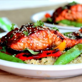 sesame ginger sweet teriyaki salmon served with a veggie-packed garlic quinoa stir-fry. This bright, flavorful dish is perfect for meal prep and weeknight dinners.