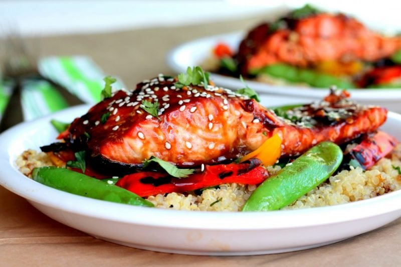 teriyaki salmon with rice and vegetables on plate