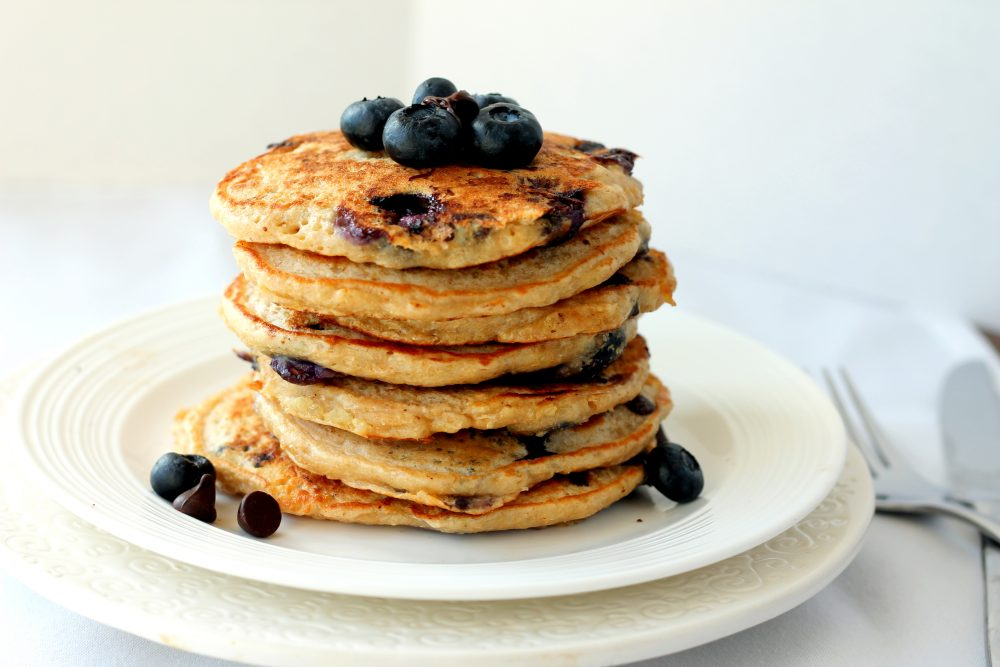 Deliciously fluffy blueberry chocolate chip quinoa pancakes packed with protein from egg whites, greek yogurt, and quinoa.