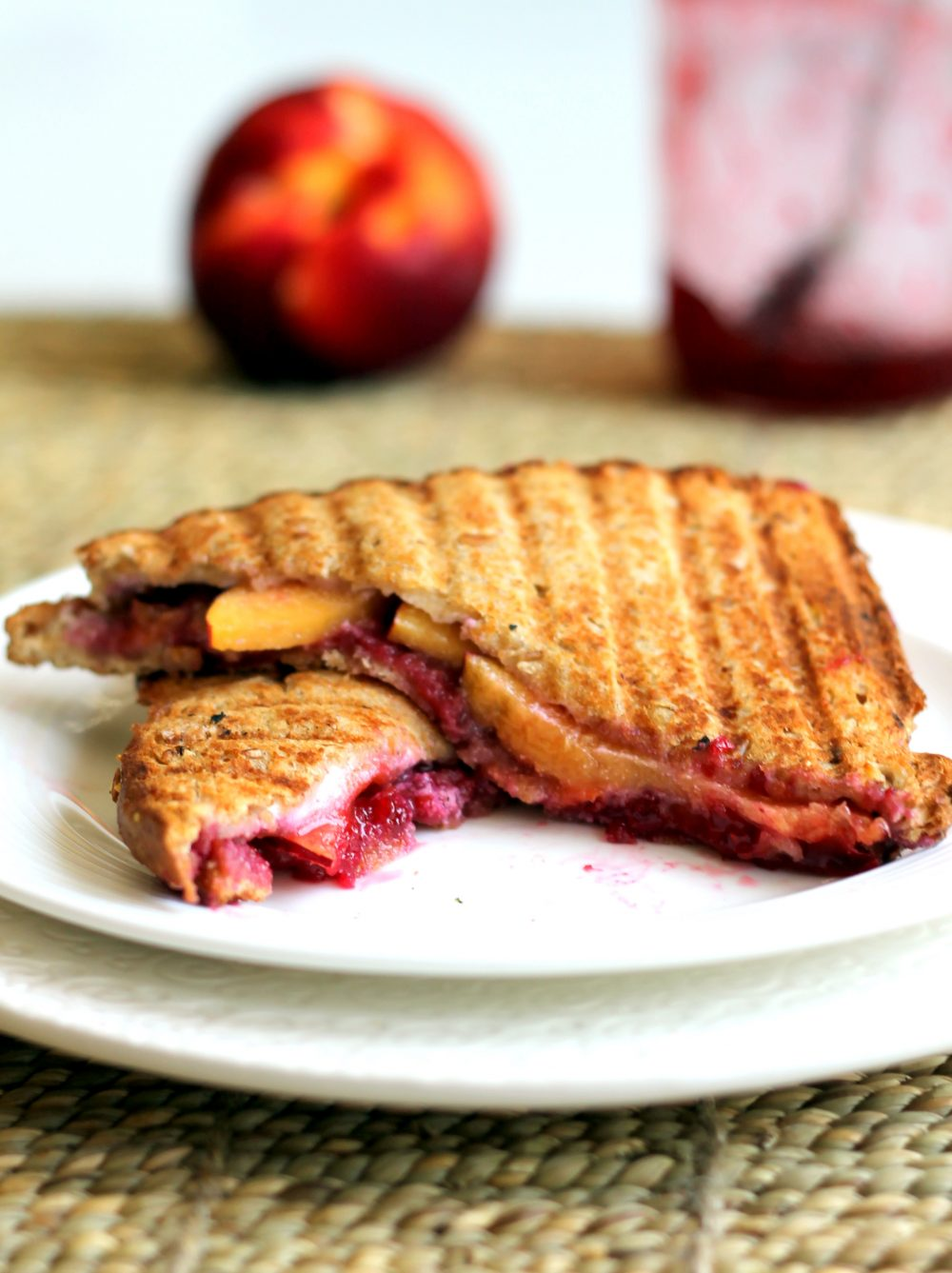 Sweet & savory grilled goat cheese sandwiches grilled to perfection with fresh peaches and raspberry jam in every bite. The ultimate grown up grilled cheese with ingredients you can feel good about.