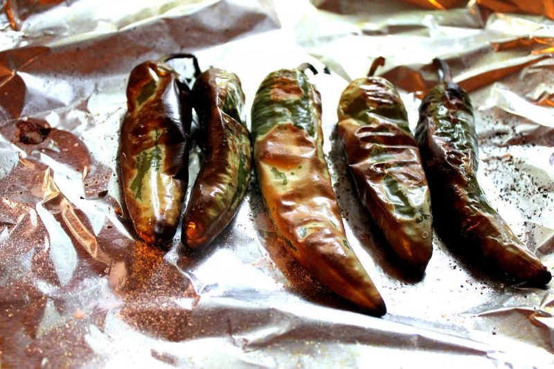 Homemade roasted green chiles on a sheet pan